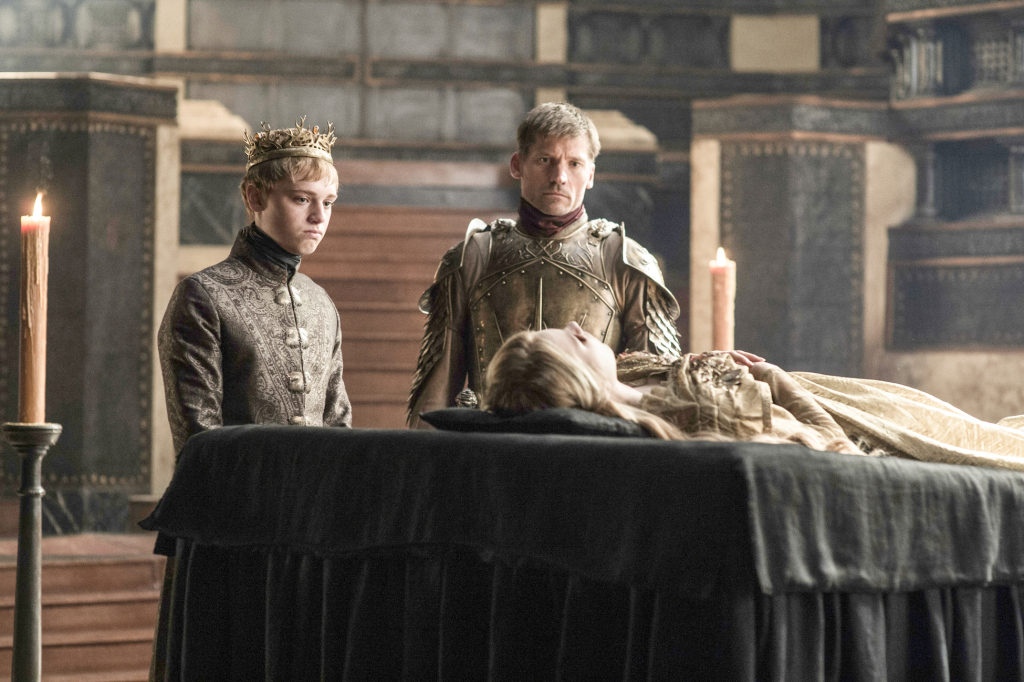 Dean-Charles Chapman as King Tommen Baratheon, Nikolaj Coster-Waldau as Jaime Lannister and Nell Tiger Free as Myrcella Baratheon – photo Helen Sloan/HBO