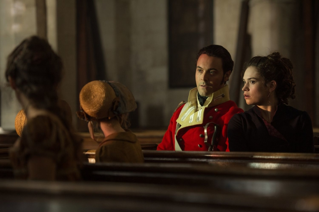Jack Huston and Lily James in Screen Gems' PRIDE AND PREJUDICE AND ZOMBIES.